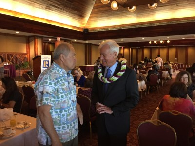 The mayor works the crowd at the Honolulu County Club in Salt Lake.
