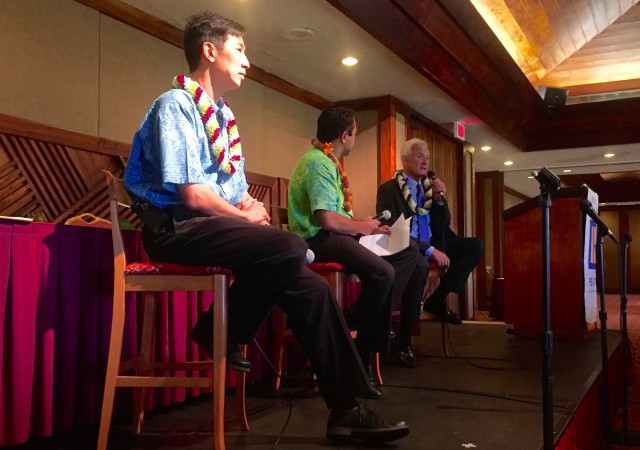 Challenger Charles Djou listens as Mayor Kirk Caldwell makes a point before the Honolulu Board of Realtors at the Honolulu County Club.