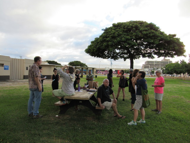 """A group of community members await the start of the Oct. 16 """"Papers in the Park"""" walking tour at Mother Waldron Park."""
