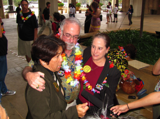 Tambry Young and Suzanne King with Justice Steven Levinson after the Hawaii House of Representatives passed civil unions legislation in 2010.