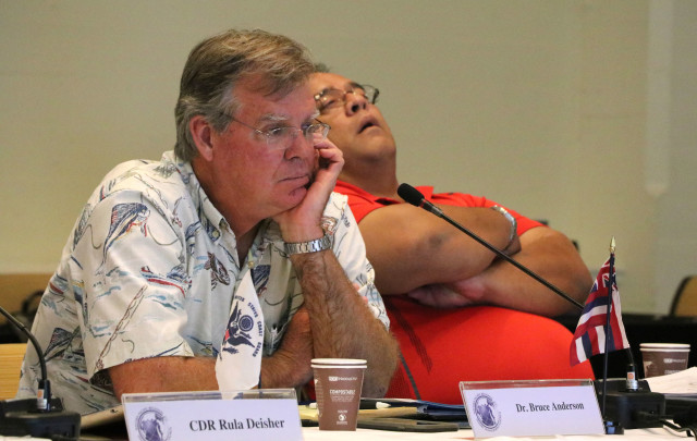 Bruce Anderson, left, administrator of the Hawaii Division of Aquatic Resources, listens next to Richard Seman, secretary of the Commonwealth of the Northern Mariana Islands Department of Land and Natural Resources, during a meeting of the Western Pacific Regional Fishery Management Council, Oct. 13, 2016, in Honolulu.