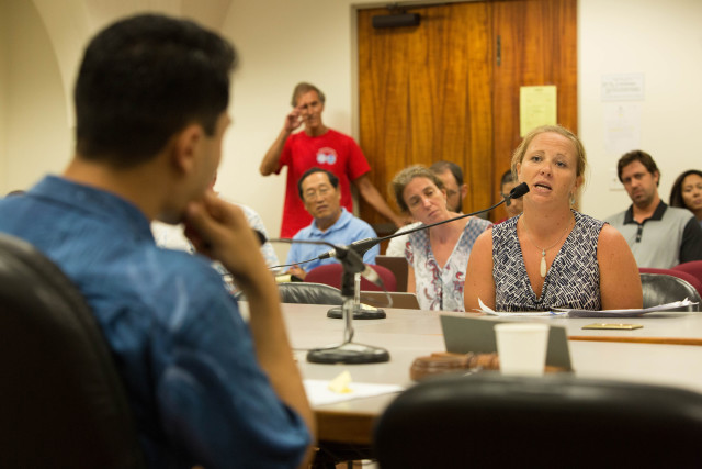 Rep. Kaniela Ing, left, asks listens to a Ashley Watts, a former federal fish observer who spent time on commercial fishing vessels.
