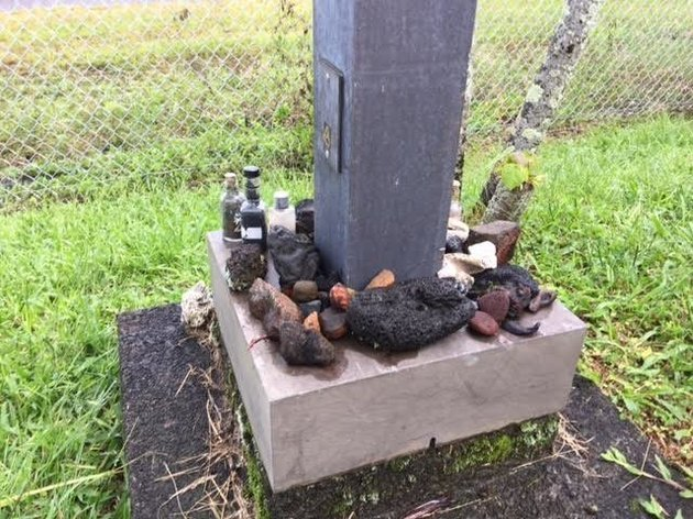 A collection of lava rocks returned to the U.S. Postal Service sits in the parking lot of the Post Office in Hilo