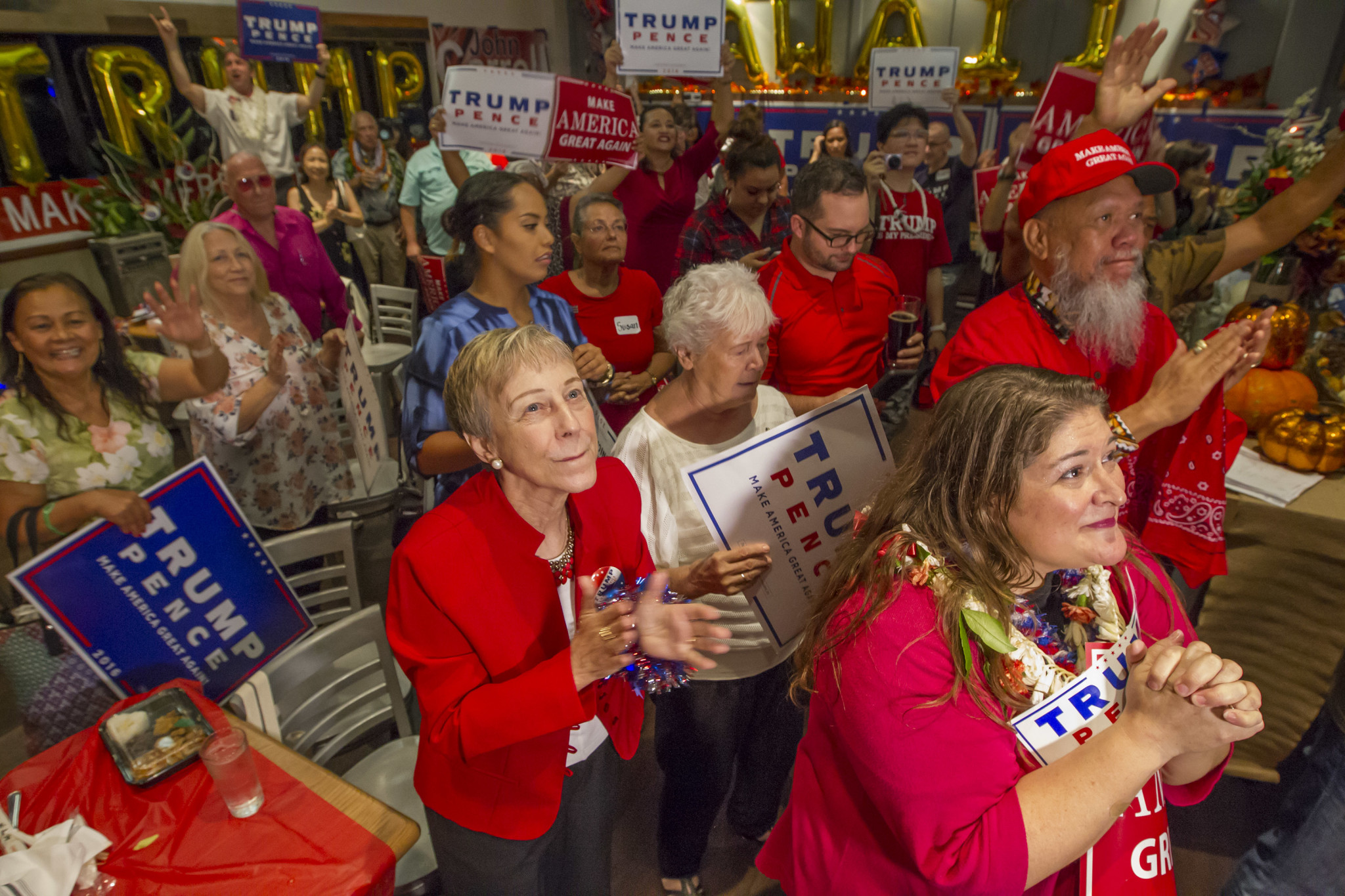 <p>The same announcement was welcomed by Trump supporters gathered at the Irons Table + Tavern restaurant. — Eugene Tanner/Civil Beat</p>