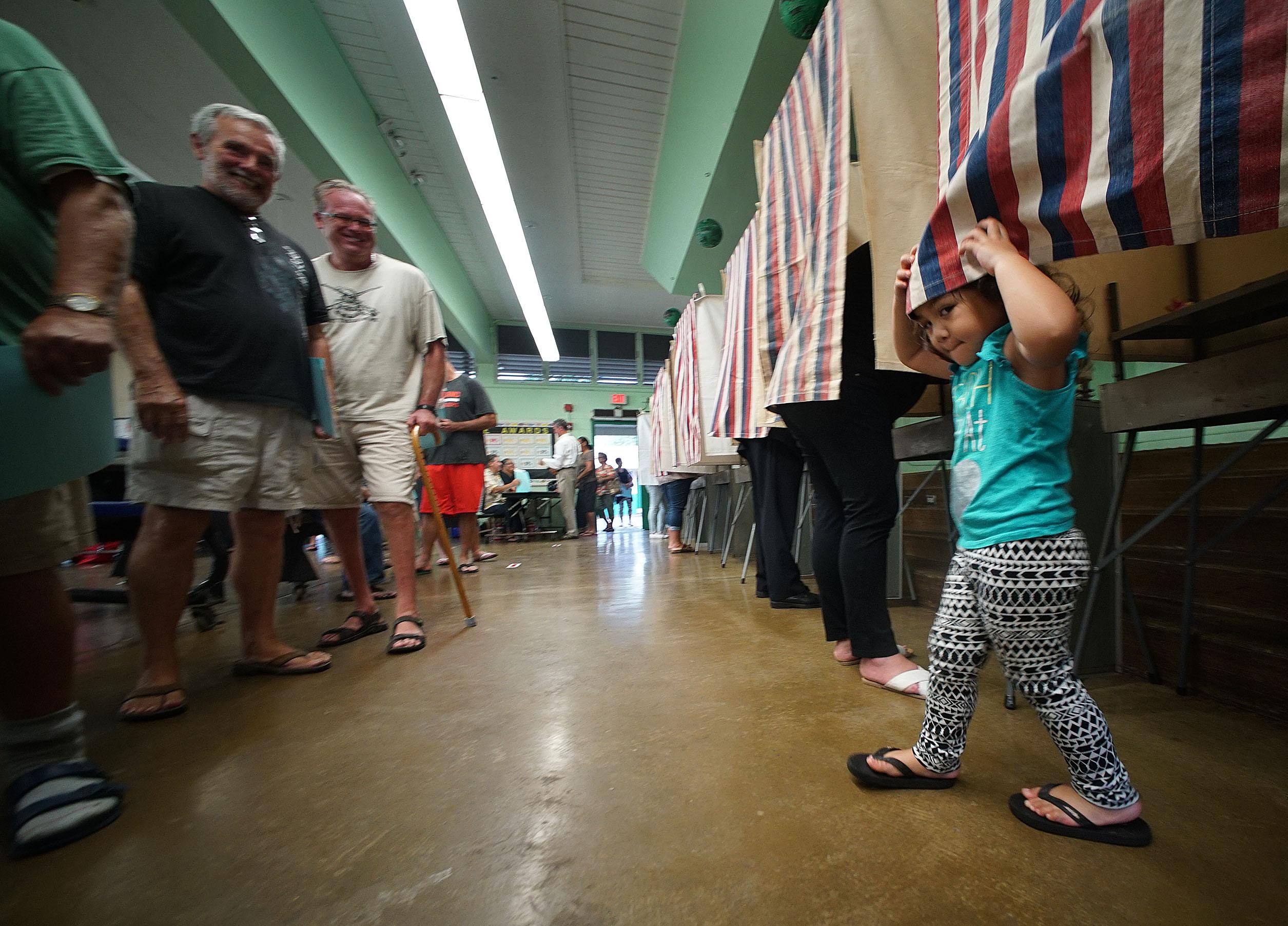 <p>Ireland Tuiono, 2, enjoyed a polling booth whilemother Kerrianne Tuiono cast her ballot Hauula Elementary. — Cory Lum/Civil Beat</p>