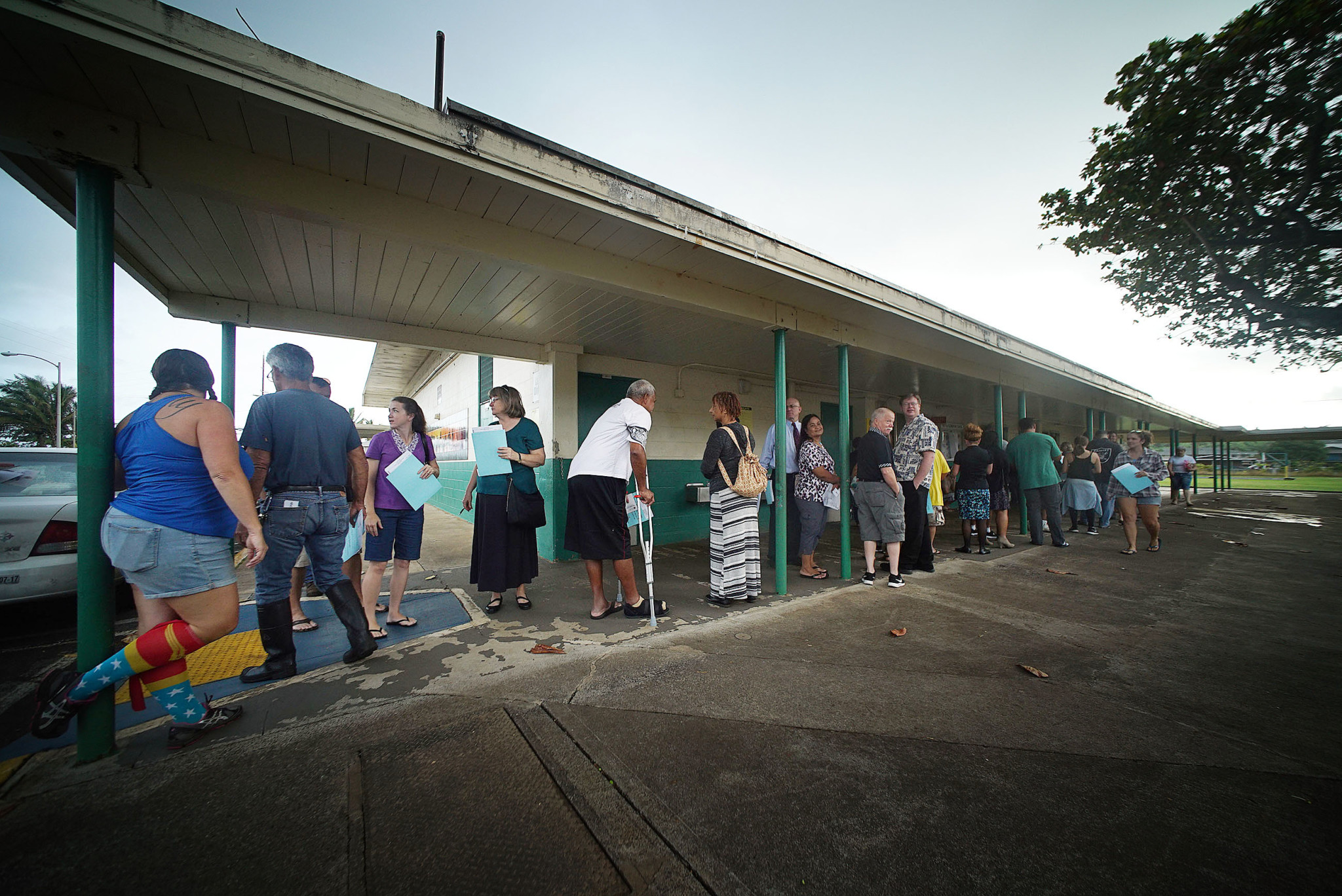<p>Scores of people queued upto have their paper ballots scanned after voting at Hauula Elementary School. Long lines were common sights at polling places. — Cory Lum/Civil Beat</p>