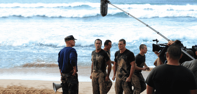 Hawaii Five-O films on a beach in Hawaii.