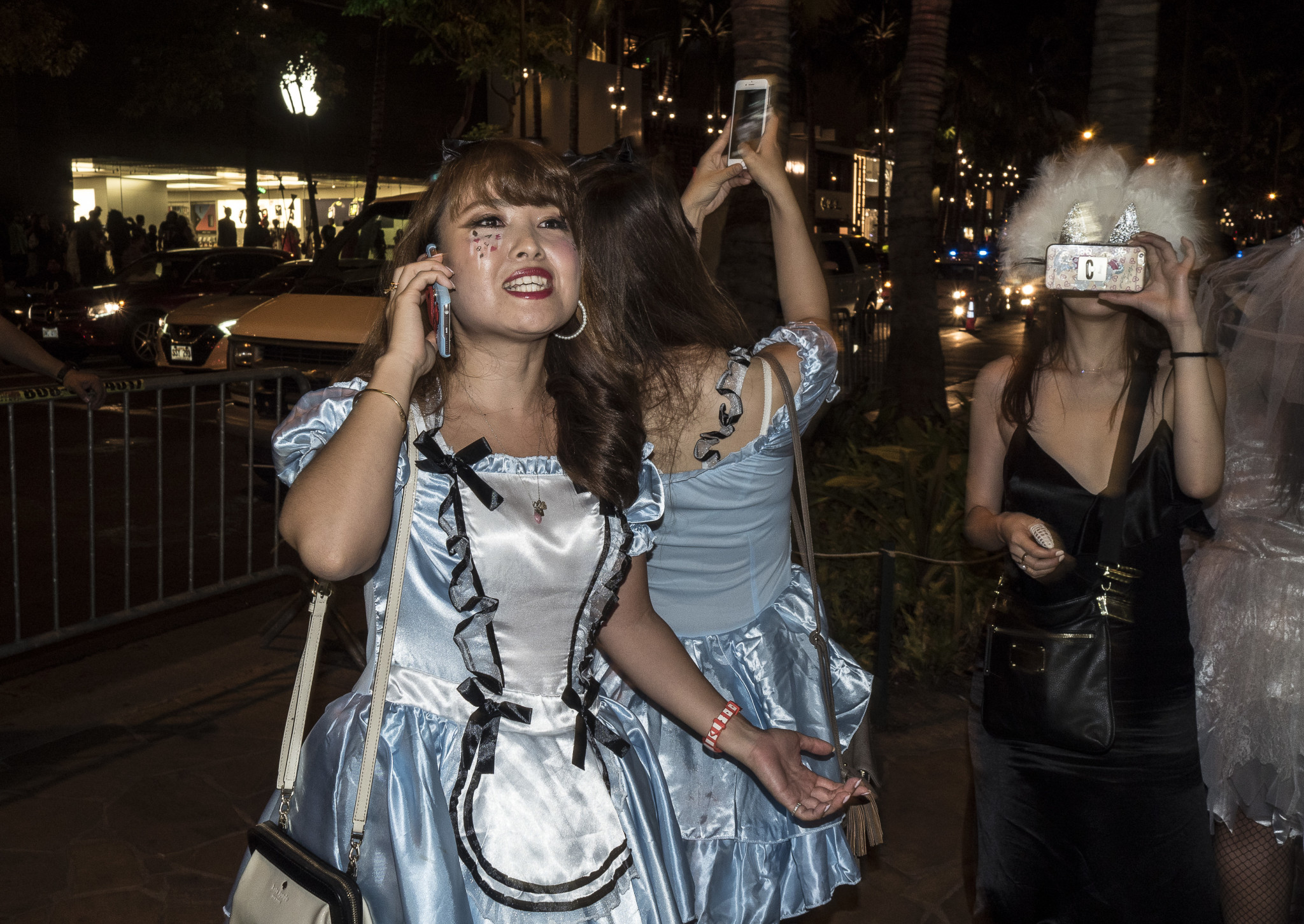 <p>Two versions of Alice in Wonderland joined a cellphone fest.</p>