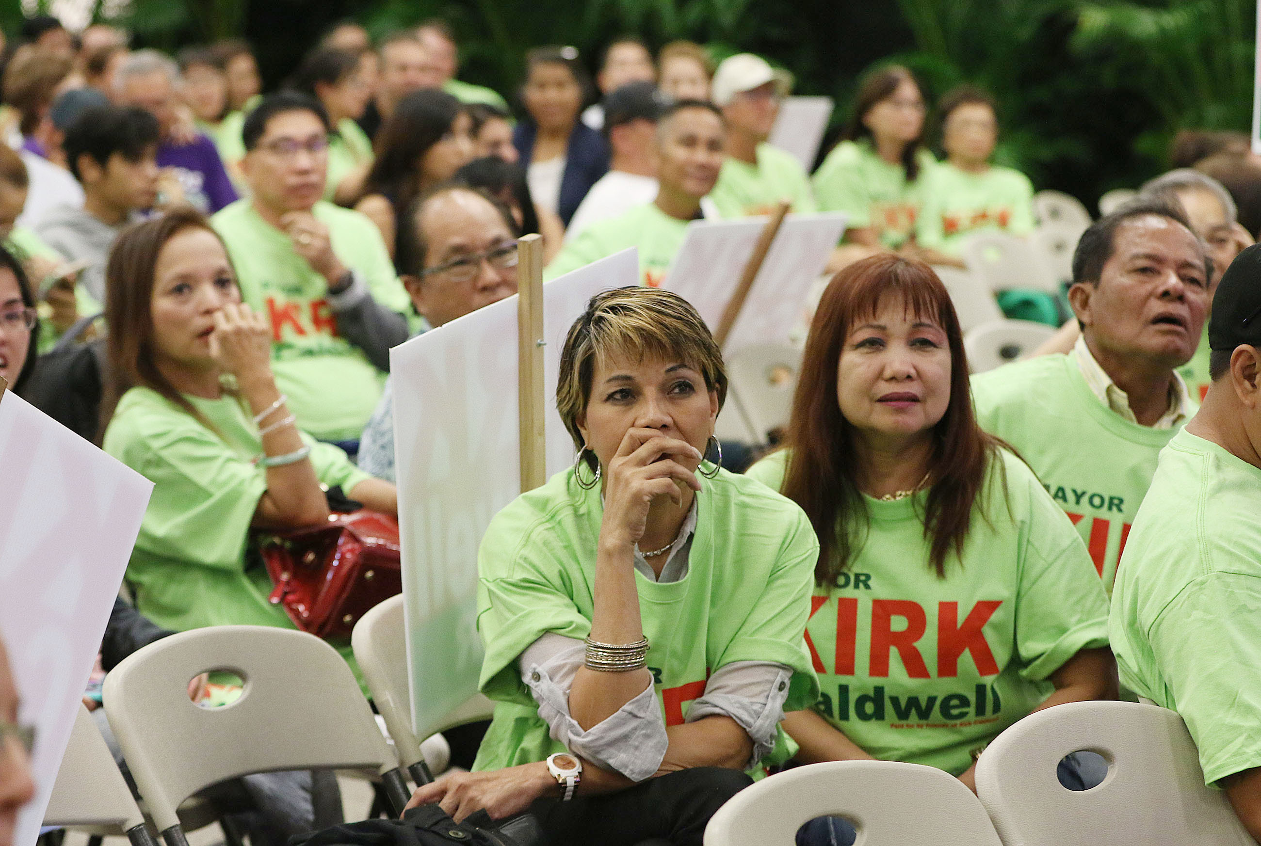 <p>Their favorite for mayor was winning, but people at Caldwell headquarters grew pensive as national returns showed an upset brewing in the presidential race. — Cory Lum/Civil Beat</p>