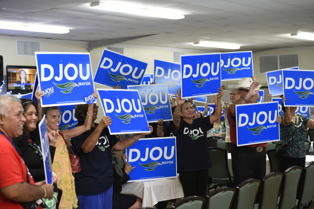 Charles Djou supporters waving sign while waiting for election results at the Pearl Country Club in Pearl City, HI, Tuesday, November 8, 2016. (Civil Beat photo by Ronen Zilberman)