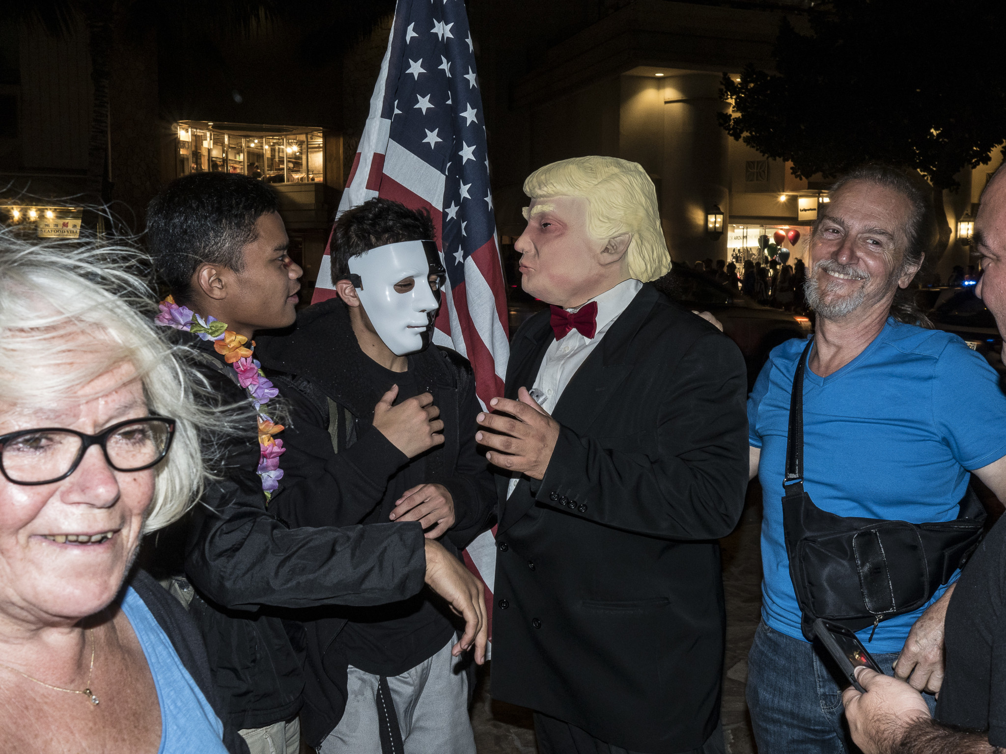 <p>Maybe it was the bow tie. This Donald Trump impersonator drew a lot of flak from passersby, but stayed in character. Note his hand size.</p>