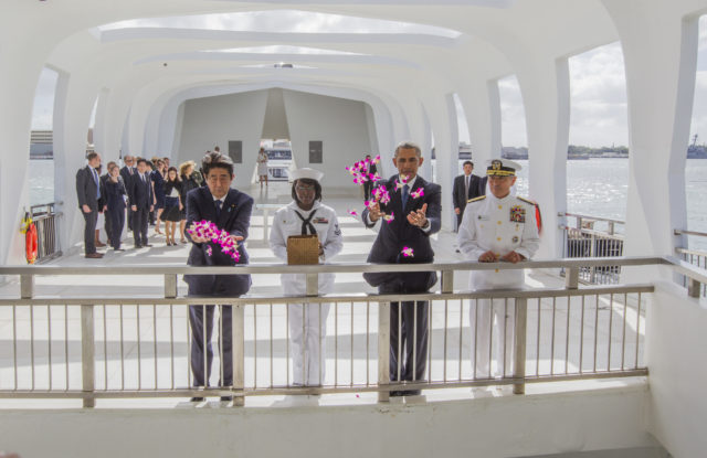 """20161227-4666 CTY OBAMA ABE MEET ARIZONAPHOTO BY DENNIS ODAPresident Obama met with Japanese Prime Minister Shinzo Abe inside the Arizona Memorial to lay wreaths (at Joint Base Pearl Harbor-Hickam in Honolulu, Hawaii). After laying wreaths, they left the inner chamber and went to the """"well"""" over the ship and threw orchids into the water. (l-r) Abe, YN2 (yeoman 2nd class) Mihelle Wrabley, Obama and Admiral Harry Harris. The meeting will be an opportunity for the two leaders to review our joint efforts over the past four years to strengthen the U.S.-Japan alliance, including our close cooperation on a number of security, economic, and global challenges. The President will also accompany Prime Minister Abe to the USS Arizona Memorial at Pearl Harbor to honor those killed. The two leadersÕ visit will showcase the power of reconciliation that has turned former adversaries into the closest of allies, united by common interests and shared values. PHOTO BY DENNIS ODA. DEC. 27, 2016. Pearl Harbor-Hickam in Honolulu, Hawaii). The meeting will be an opportunity for the two leaders to review our joint efforts over the past four years to strengthen the U.S.-Japan alliance, including our close cooperation on a number of security, economic, and global challenges. The President will also accompany Prime Minister Abe to the USS Arizona Memorial at Pearl Harbor to honor those killed. The two leadersÕ visit will showcase the power of reconciliation that has turned former adversaries into the closest of allies, united by common interests and shared values. PHOTO BY DENNIS ODA. DEC. 27, 2016."""