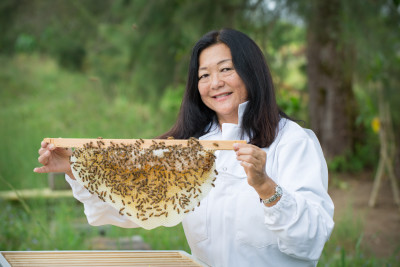 Lorna Tsutsumi , a beekeeping professor at UH Hilo's teaching farm in Panaewa outside of Hilo.