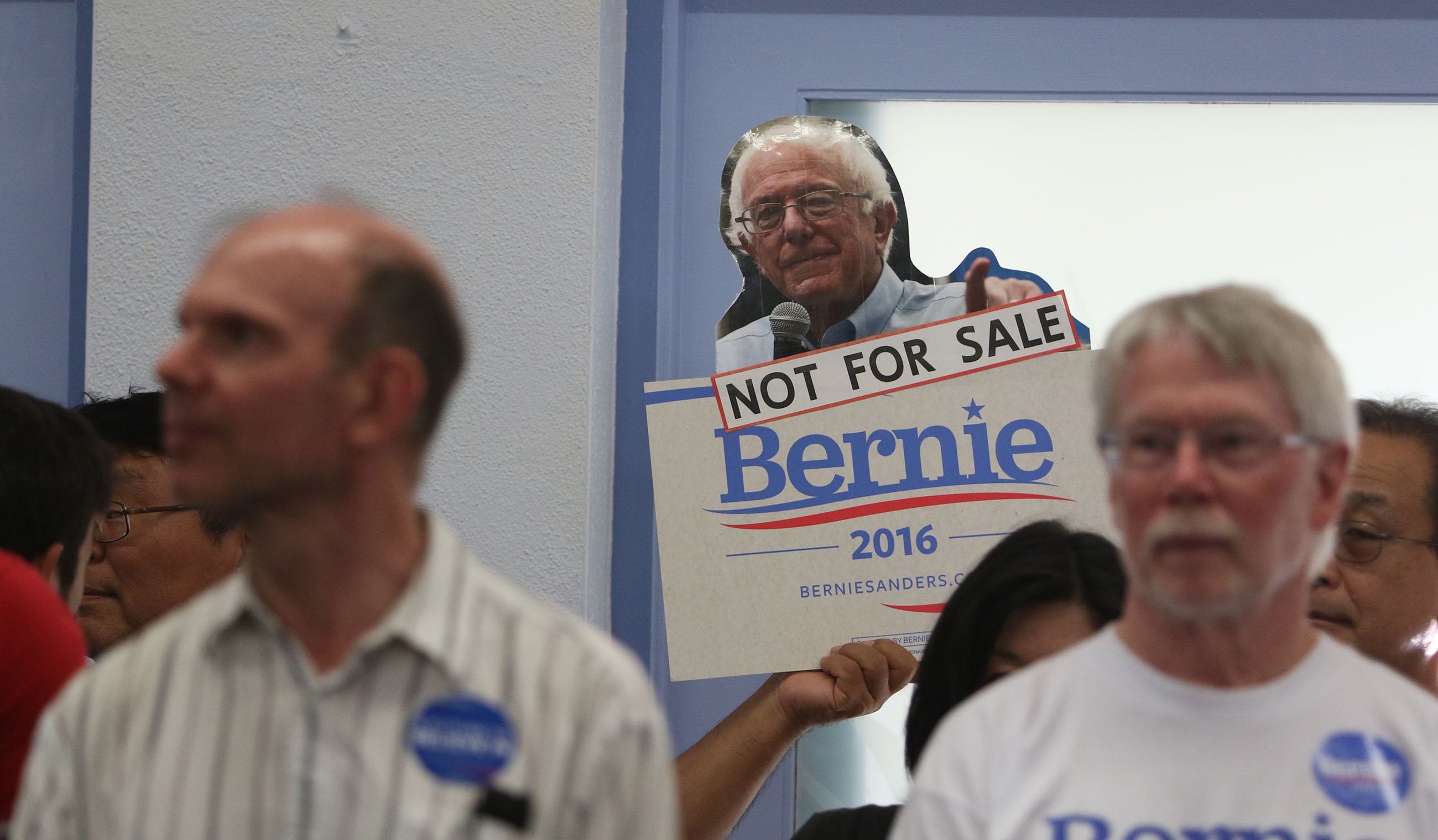 <p>March 20: Supporters of the presidential campaign of Vermont Sen. Bernie Sanders during the visit of his wife, Jane, to the Church of the Crossroads in Honolulu. Just days later, Sanders trounced Hillary Clinton in Hawaii's Democratic presidential preference poll. <em>Cory Lum/Civil Beat</em></p>