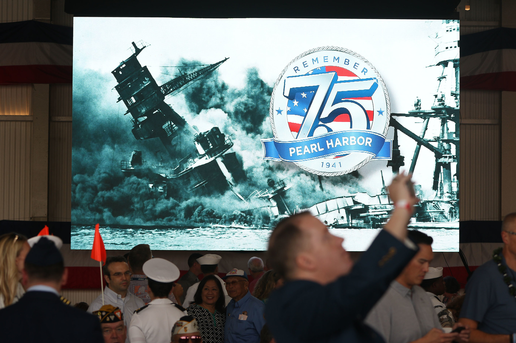 <p>Visitors mingled at Kilo Pier before the ceremony, which was held almost 75 years to the minute after Japanese aircraft started bombing Oahu.</p>