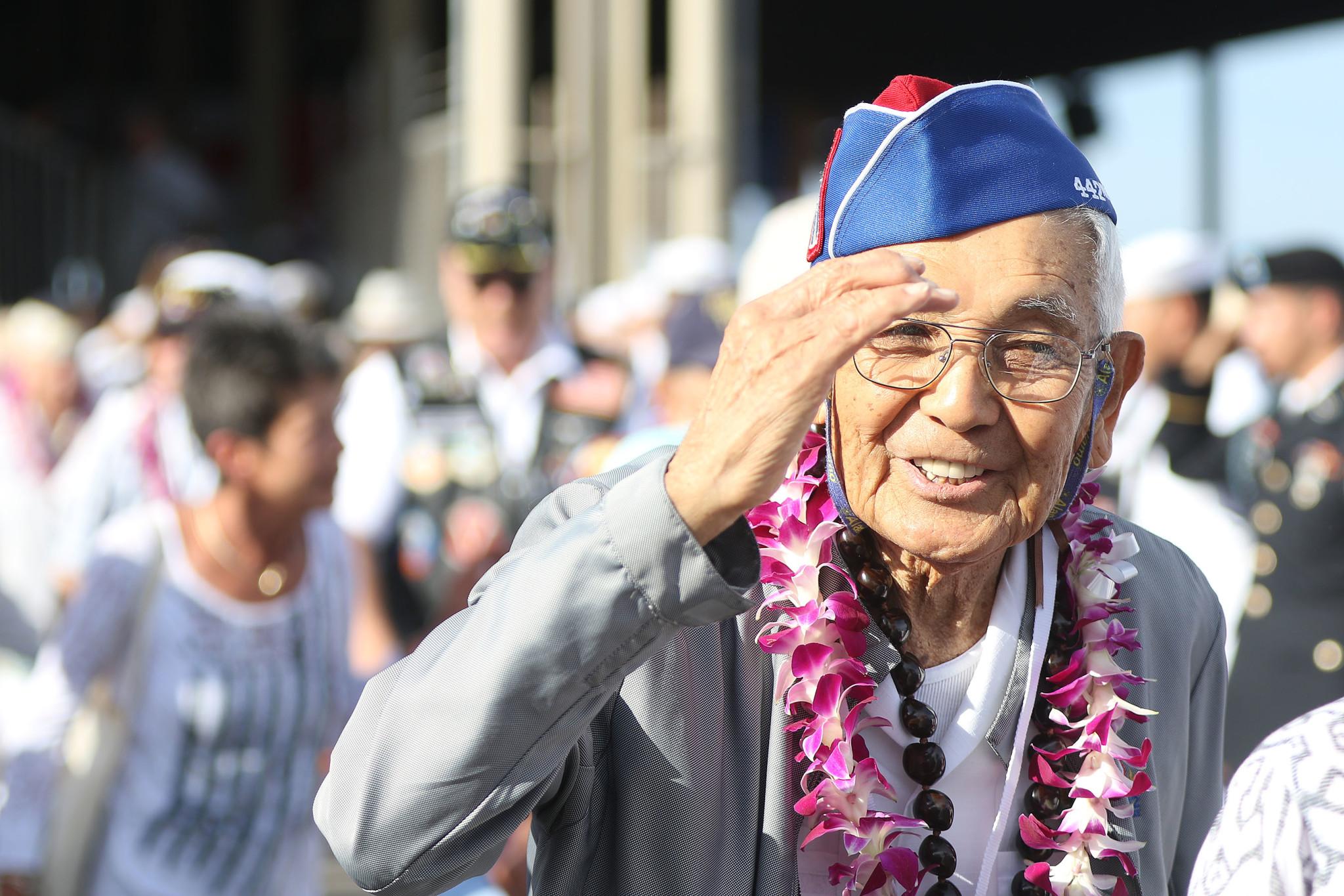 <p>World War II veteran Robert Kishinamiof the 442nd Regimental Combat Team returns a salute from active-duty personnel.</p>