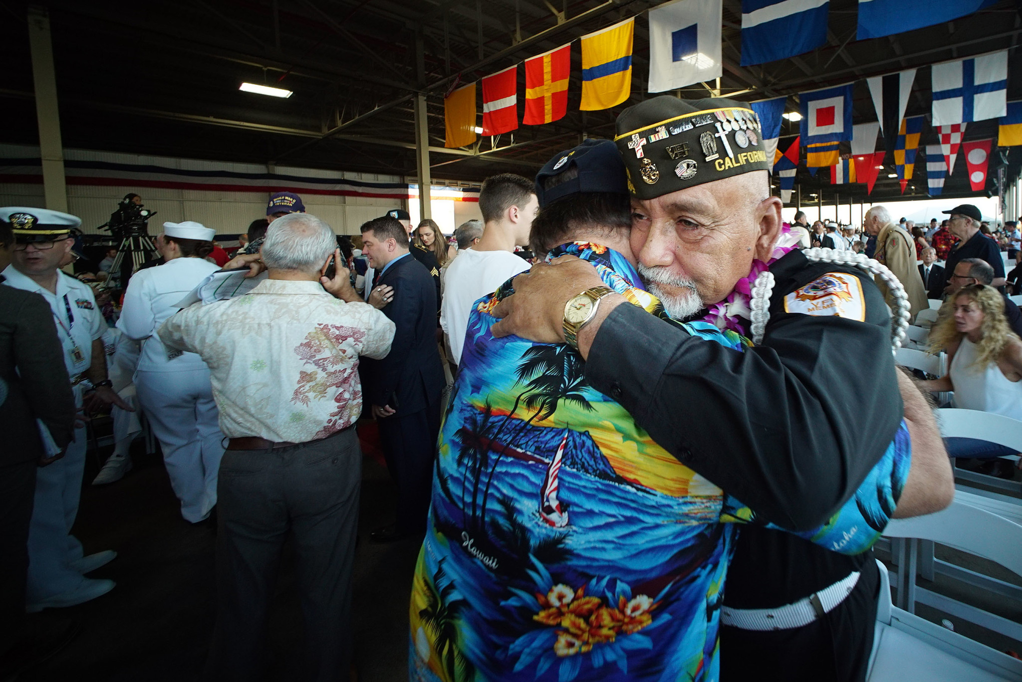 <p>Vietnam veteran Jim Corrales of California hugged a fellow vet before the ceremony. In all, 2,403 Americans died in the attack.</p>