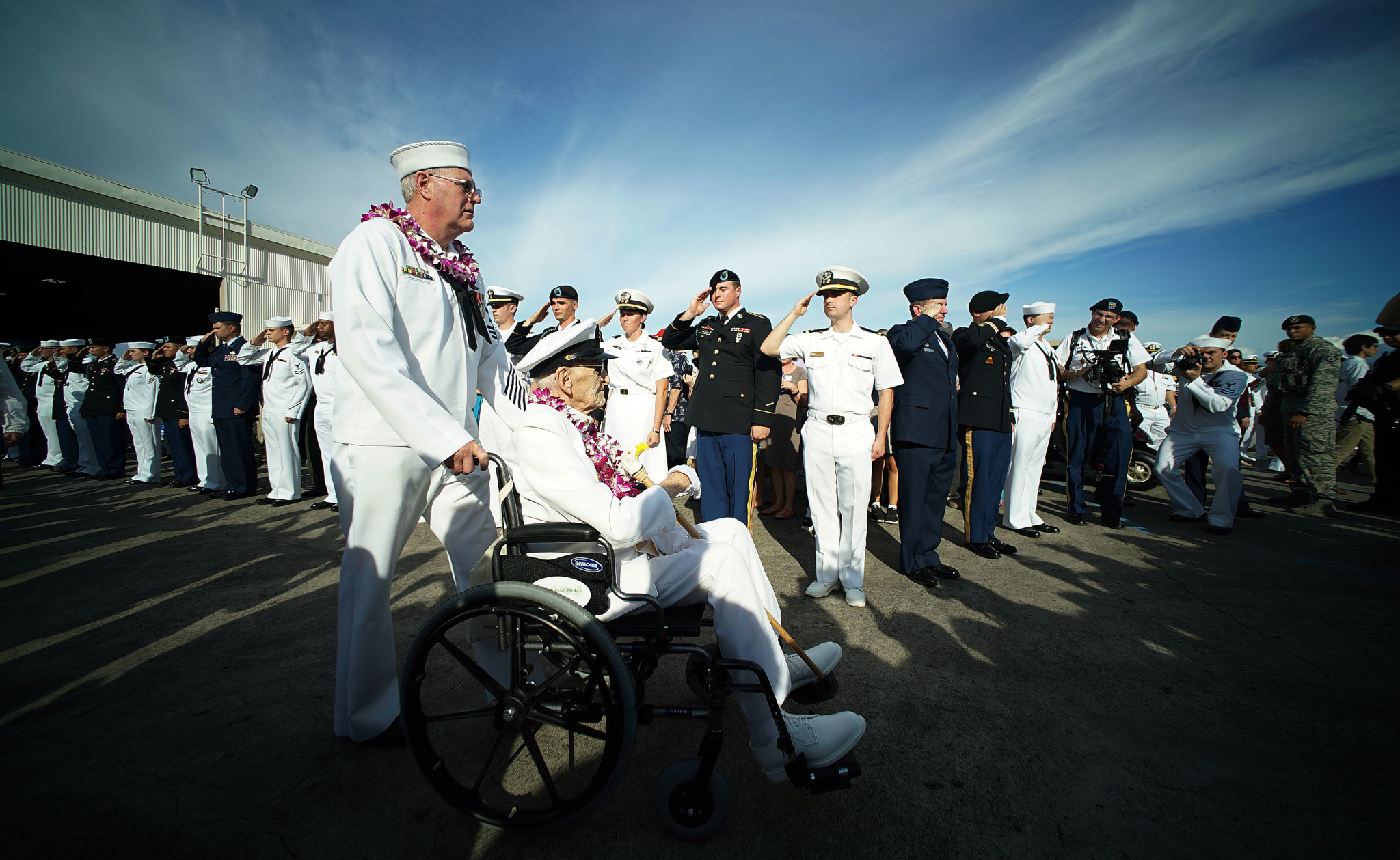 <p>As they exited the ceremony, Pearl Harbor survivors and other World War II veterans were saluted by active-duty personnel from all branches.</p>