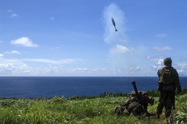 Marines fire an 81 mm mortar while training on Farallon de Medinilla on September 16.