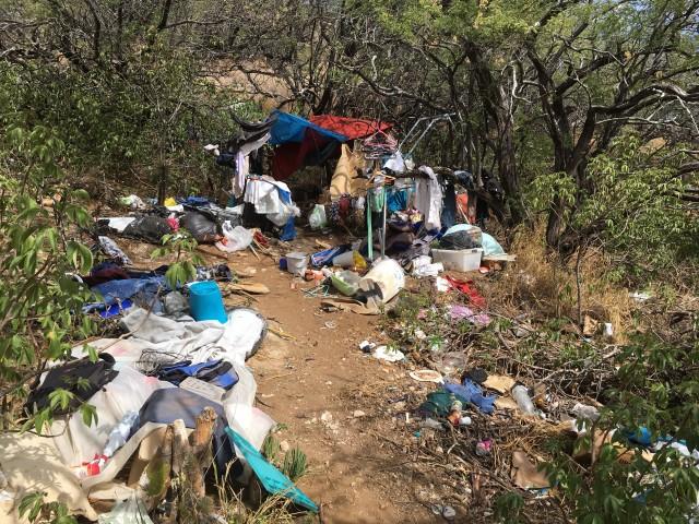 A trashed homeless encampment on Diamond Head.