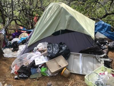 Another trash-strewn encampment on Diamond Head.