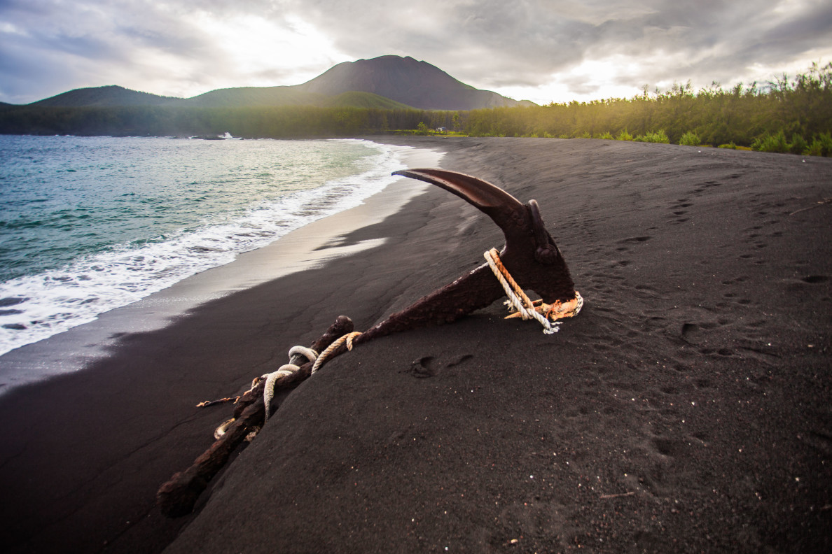 An anchor sits on a Pagan beach. The island's active volcano and lack of development makes it a hard place to live, but still some call it home.