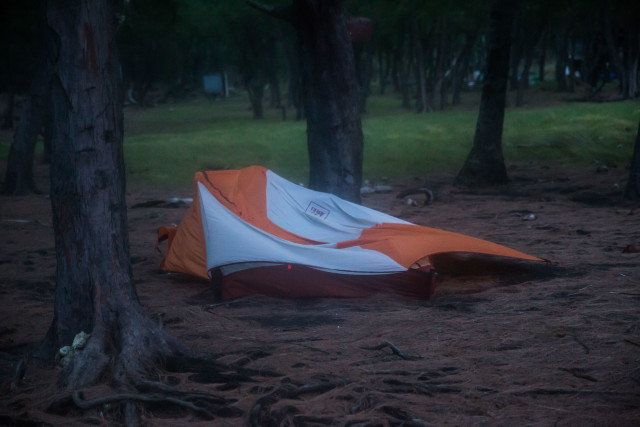 My sad little orange tent didn't hold up well in the pounding storm.