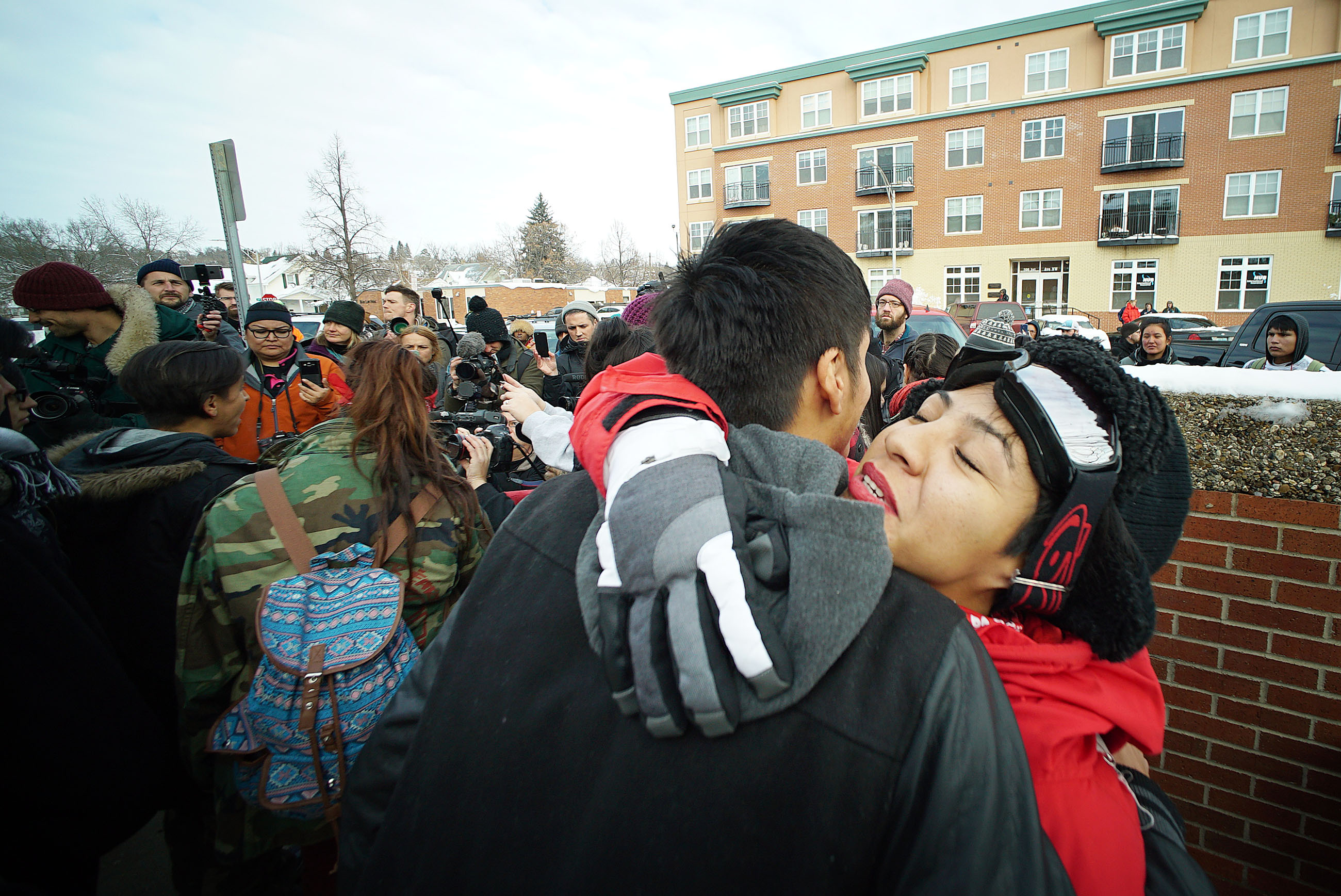 <p>After the delivery in Mandan, Mia Stevens, right, embraced another protester.</p>