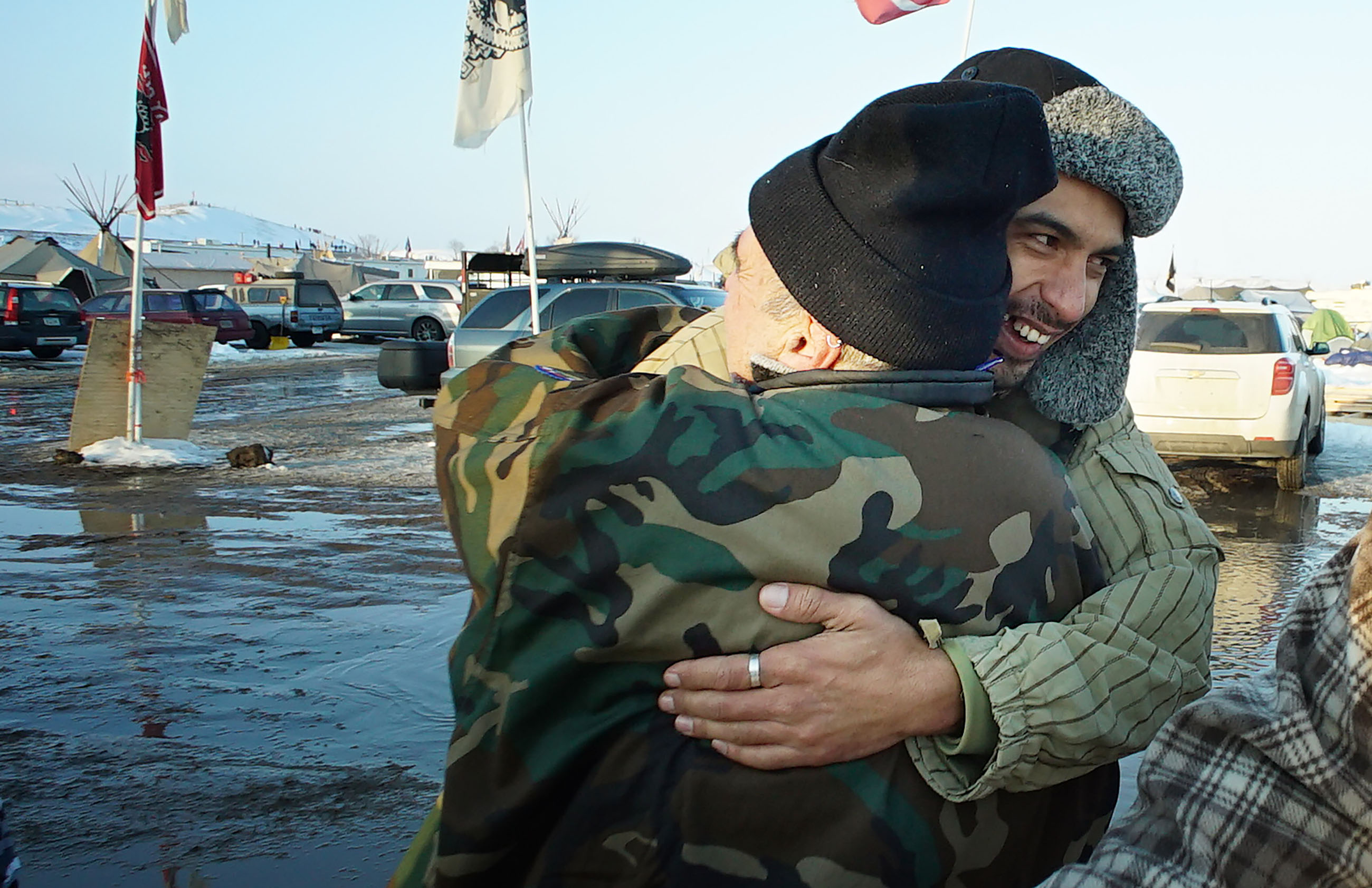 <p>Another Hawaiian at Standing Rock was Leomana Turalde, right, a Marine Corps veteran from the Big Island who served in Iraq. He hugged a Vietnam veteran at the camp. They were among hundreds of vets who arrived to support the protest.</p>