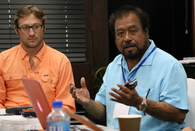 Noah Idechong, Palau's former House of Delegates speaker and previous head of the country's marine resources division, right, works with The Nature Conservancy's Mark Zimring, left, on fishery management initiatives.