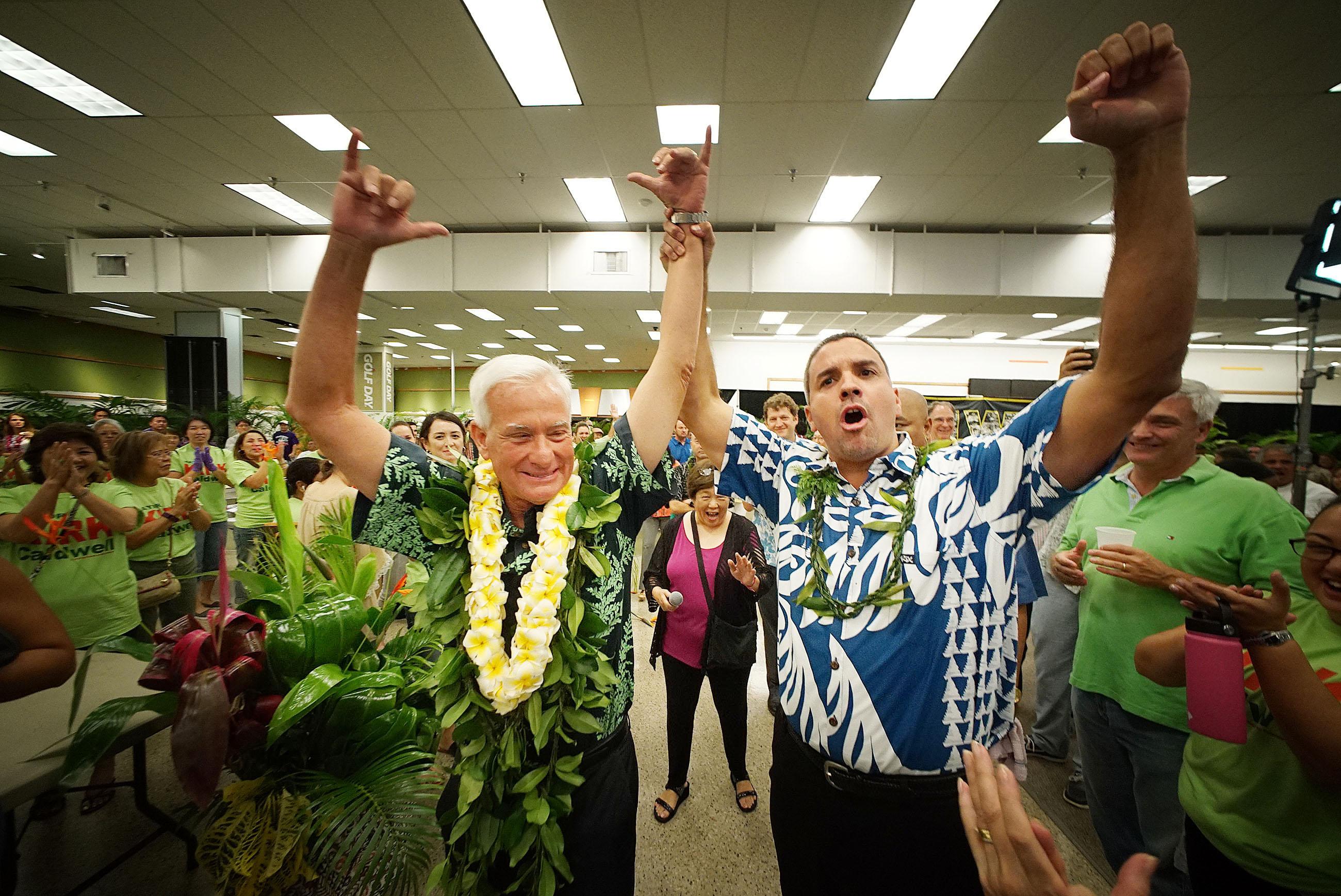 <p>Nov. 8: Honolulu Mayor Kirk Caldwell exults with City Councilman Ikaika Anderson as election night results show Caldwell winning his re-election bid. <em>Cory Lum/Civil Beat</em></p>