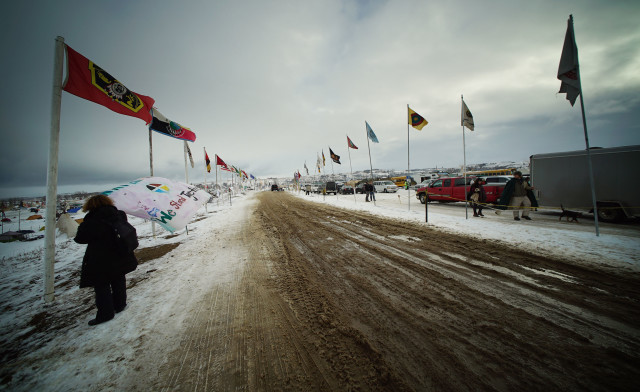 Oceti Sakowin Camp with flags off of Highway 1806 near the Cannonball River. N. Dakota. 1 dec 2016