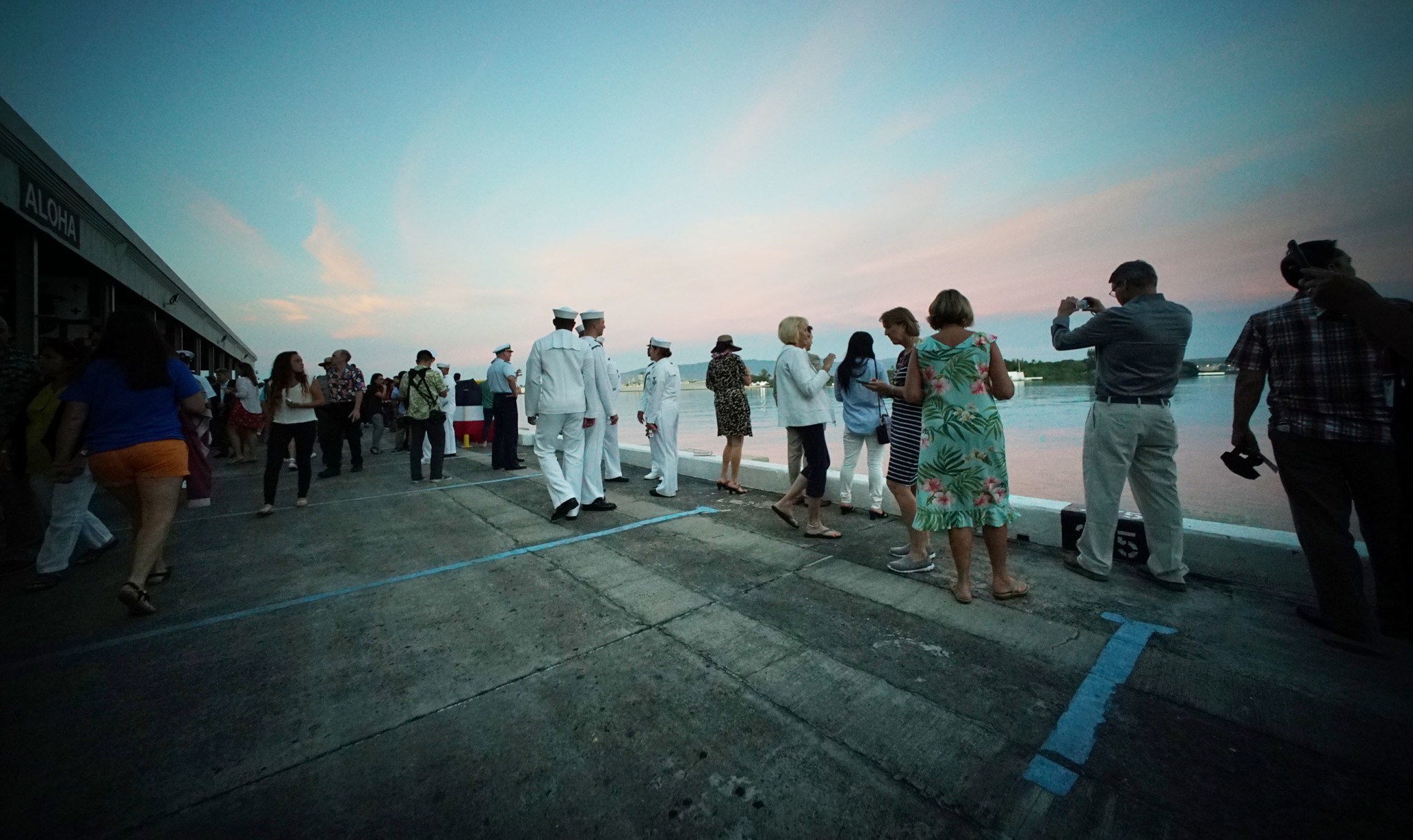 <p>Before the Wednesday morning National Pearl Harbor Remembrance Day Commemoration Ceremony, visitors checked out the sunrise.</p>