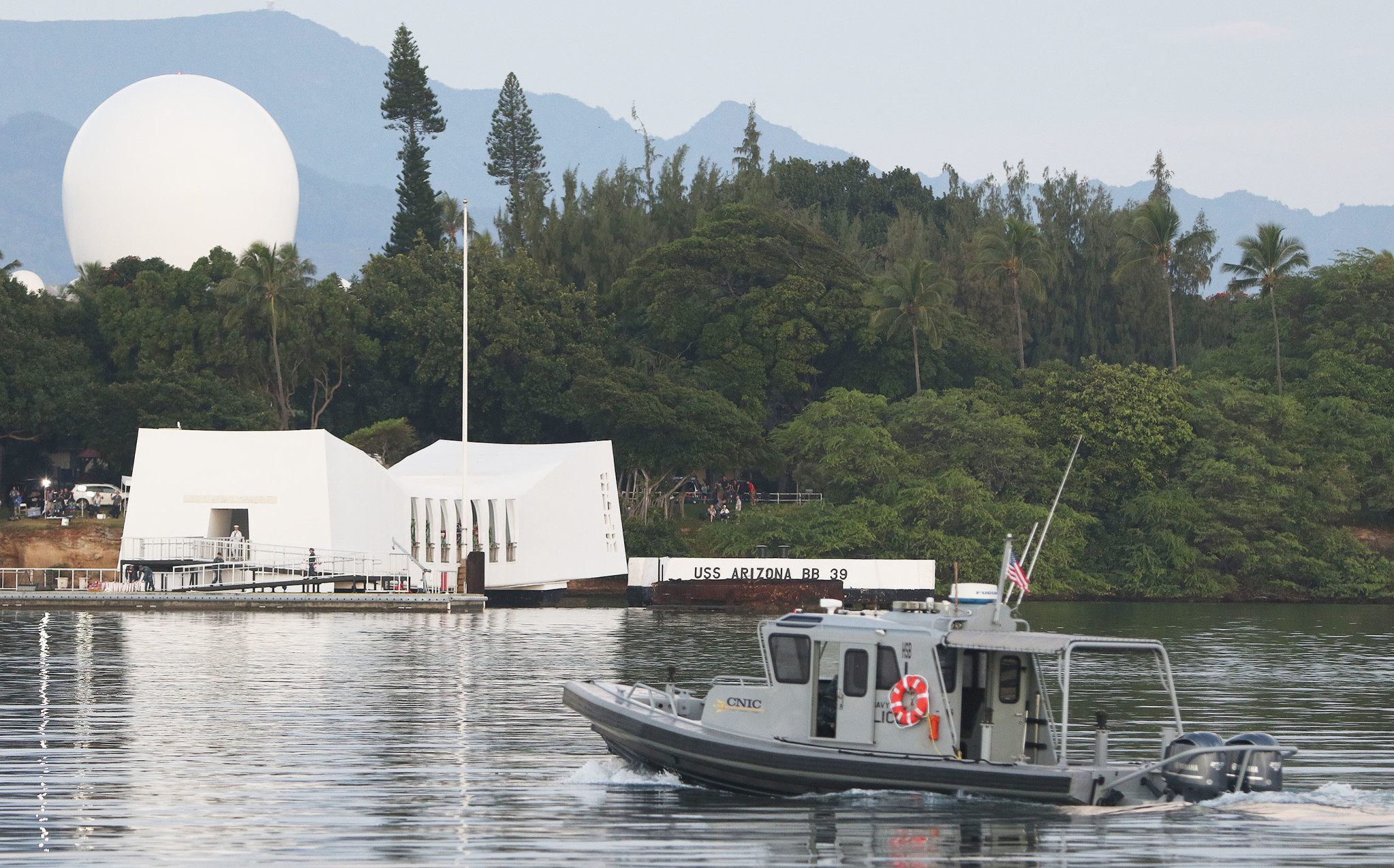 <p>A Navy vessel plied the harbor near the USS Arizona Memorial straddling the wreckage of the battleship where 1,177 sailors and marines died.</p>