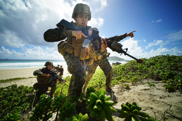 fault lines US Marines storm Pyramid Rock Beach Marine Corps Base Hawaii after landing on beach via Amphibious Assault Vehicles in RIMPAC exercises. Kaneohe Hawaii. 30 july 2016