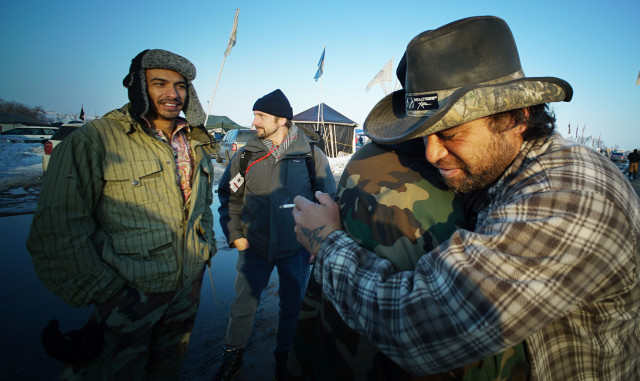 Standing Rock Michael Kyser Jr hugs a Vietnam veteran as left, Leomana Turalde looks on at Standing Rock camp. 3 dec 2016
