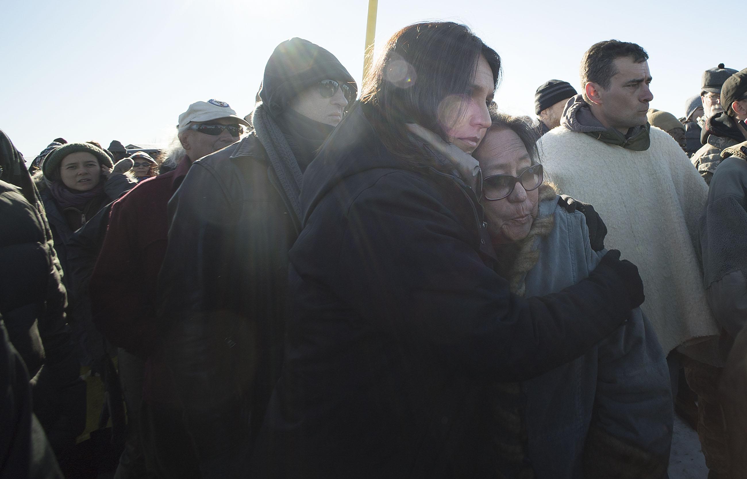 <p>HawaiiCongresswoman Tulsi Gabbard, center, hugged Phyllis Young after Gabbard spoke to the assembled veterans.</p>
