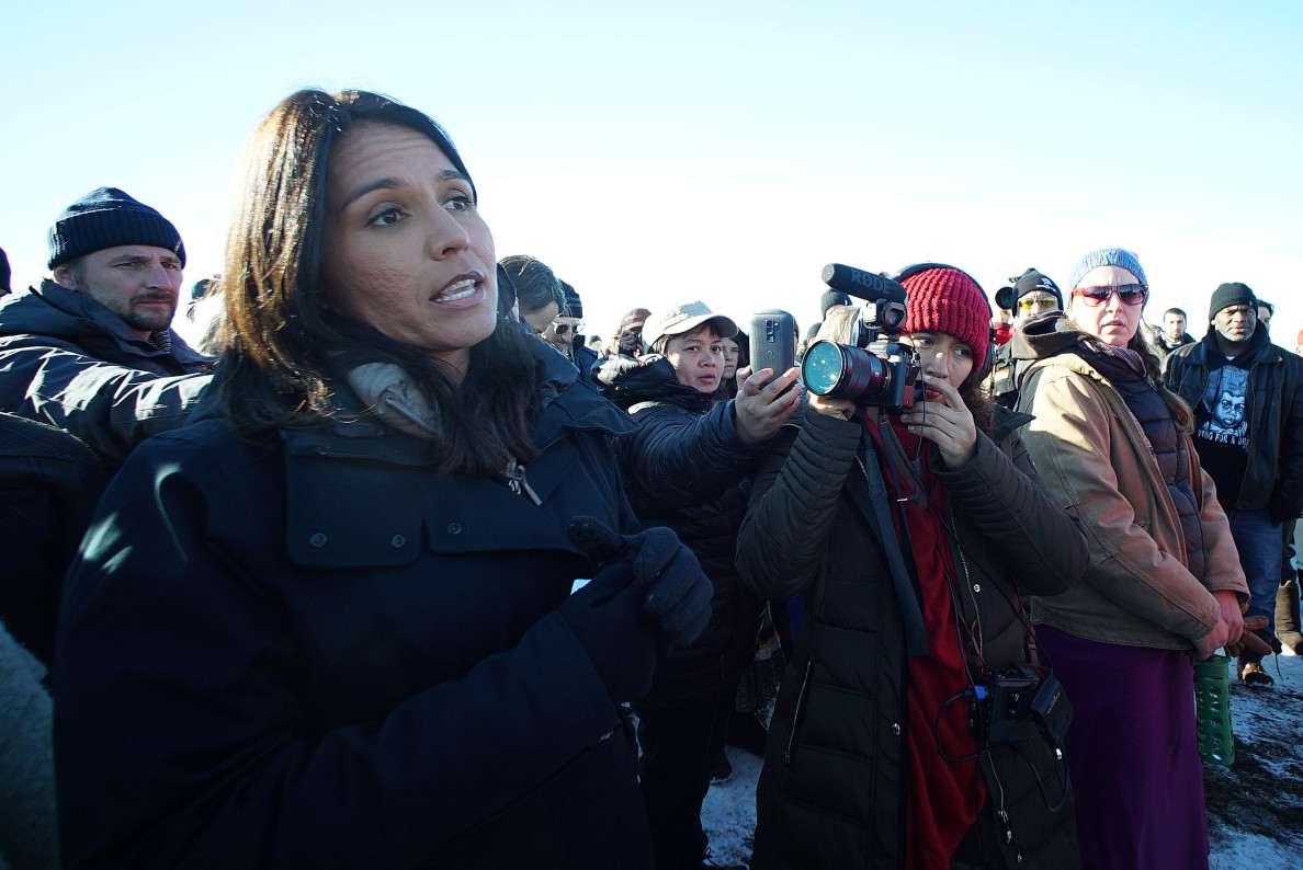 Congresswoman Tulsi Gabbard answers a question shouted out from the gathering of veterans and media on a field near Cannonball, N Dakota. 4 dec 2016