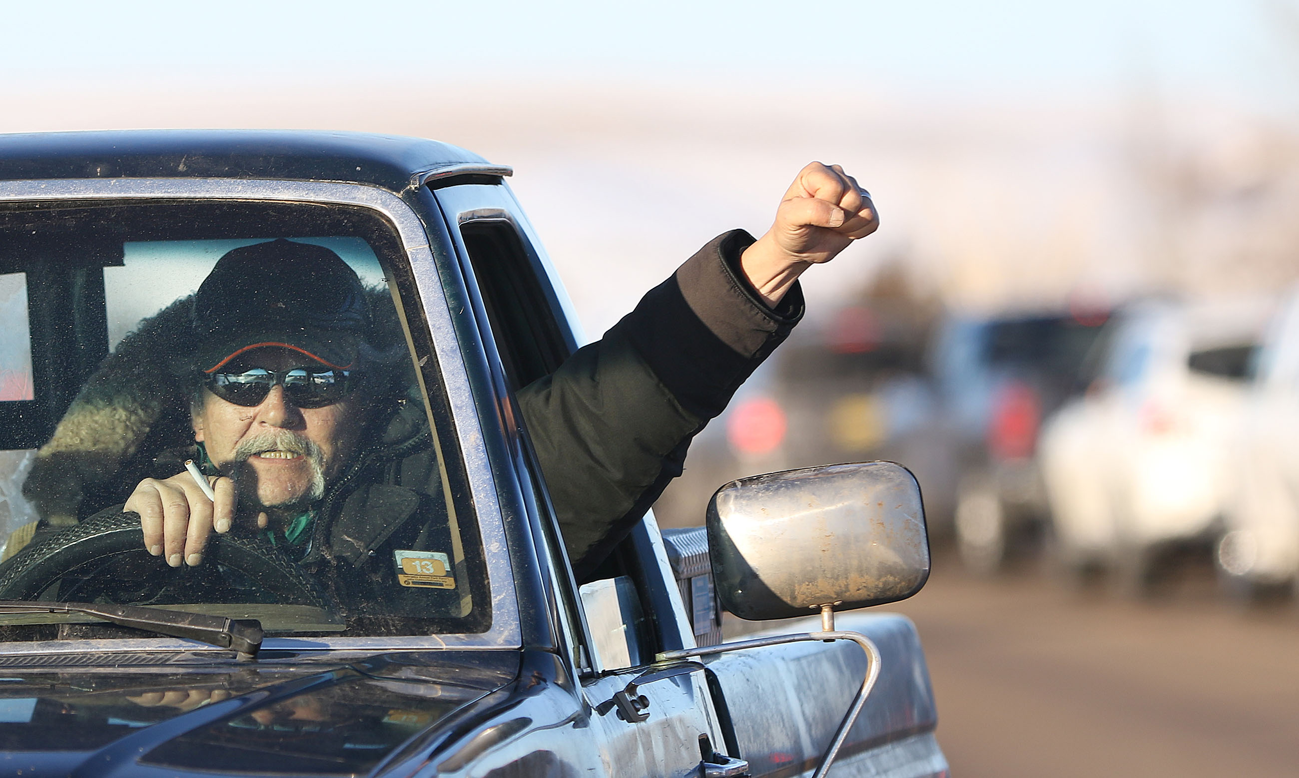 <p>The veterans hadn't been on the scene at Standing Rock for long when the U.S. Army Corps of Engineers announced it was halting the pipeline project to study alternative routes that would take it farther from the reservation's water supply. One protester celebrated with a raised fist.</p>