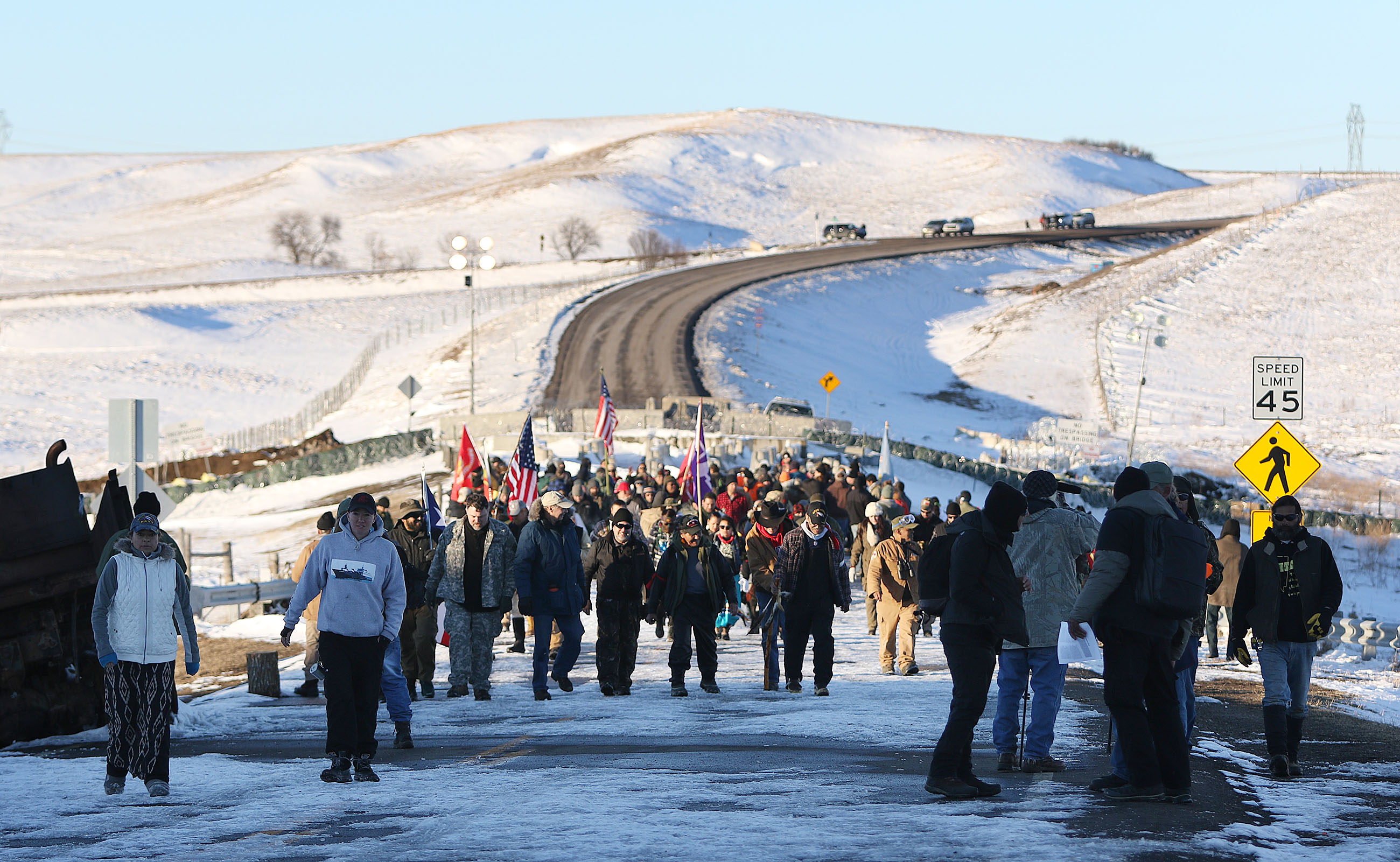<p>After the Army Corps announcement, a group of veterans and other protesters marched near a Highway 1806 bridge.</p>