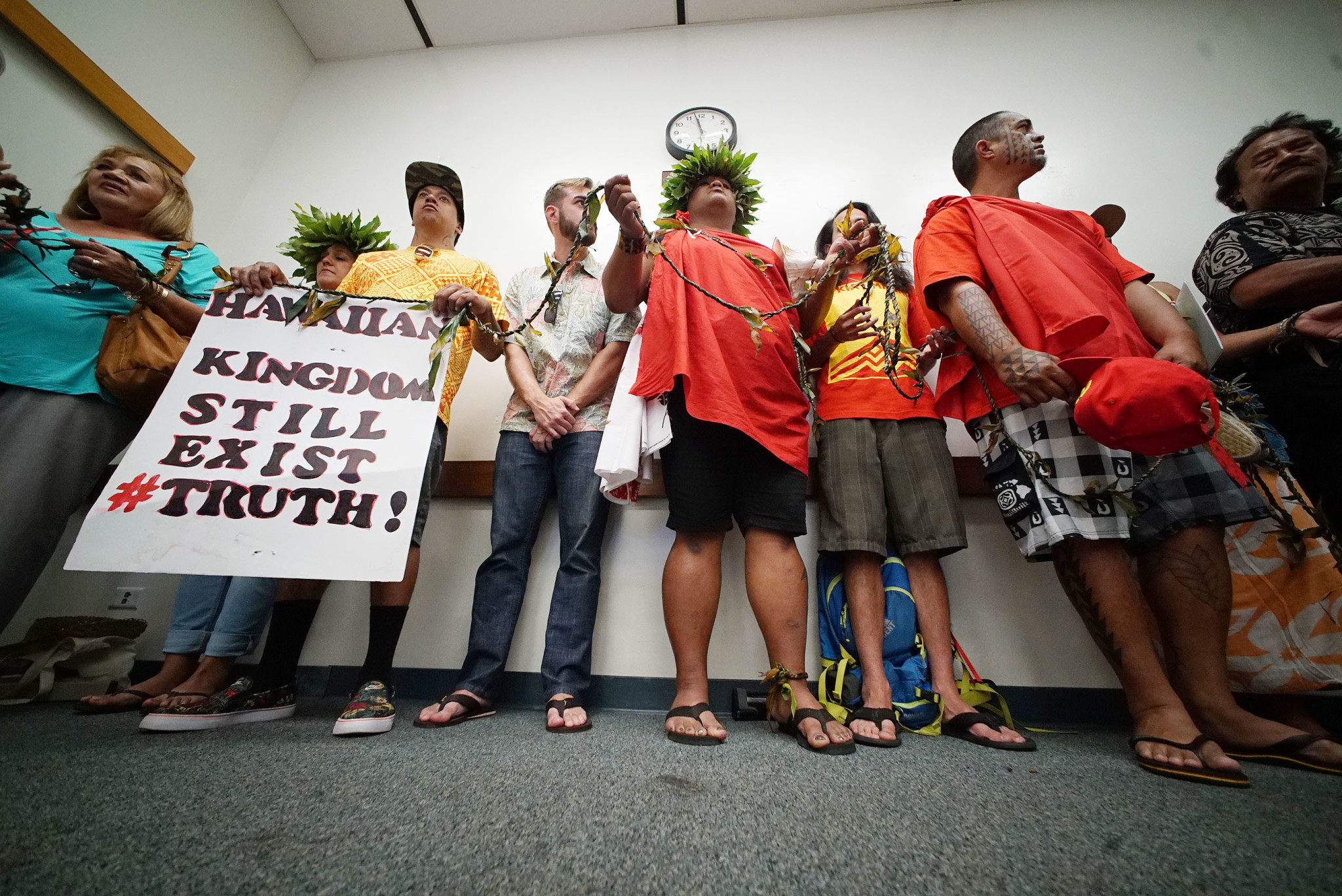 <p>May 16: Opponents of the proposed Thirty Meter Telescope atop Mauna Kea at a permit hearing before a judge appointed by the Department of Land and Natural Resources. <em>Cory Lum/Civil Beat</em></p>