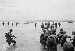 U.S. troops wade ashore Saipan during World War II.