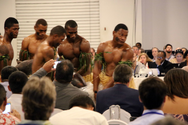 Fijians carry a pig during the opening of the Western and Central Pacific Fisheries Commission meeting Monday at the Sheraton Fiji Resort.
