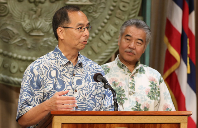 Wes Machida had to step in to discuss some numbers after Governor Ige called him up to the podium during press conference. 19 dec 2016