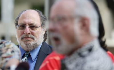 Federal Public Defender Alexander Silvert looks on as HPD commission Steven Levinson speaks to media. 16 dec 2016