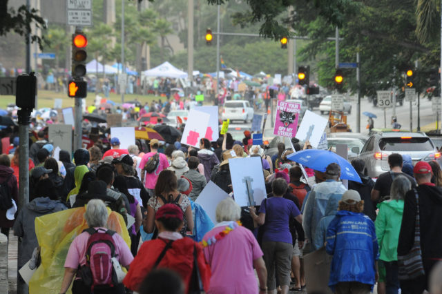 People walk together in the streets of Honolulu for the Women's March in Honolulu, HI on Saturday, January 21, 2017. (Civil Beat photo by Ronen Zilberman)