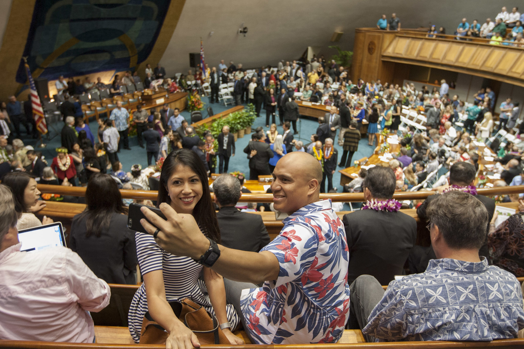 <p>Abbi and Michael Namocot of Ewa Beach snap a selfie as legislators assemble in the Senate chamber.</p>