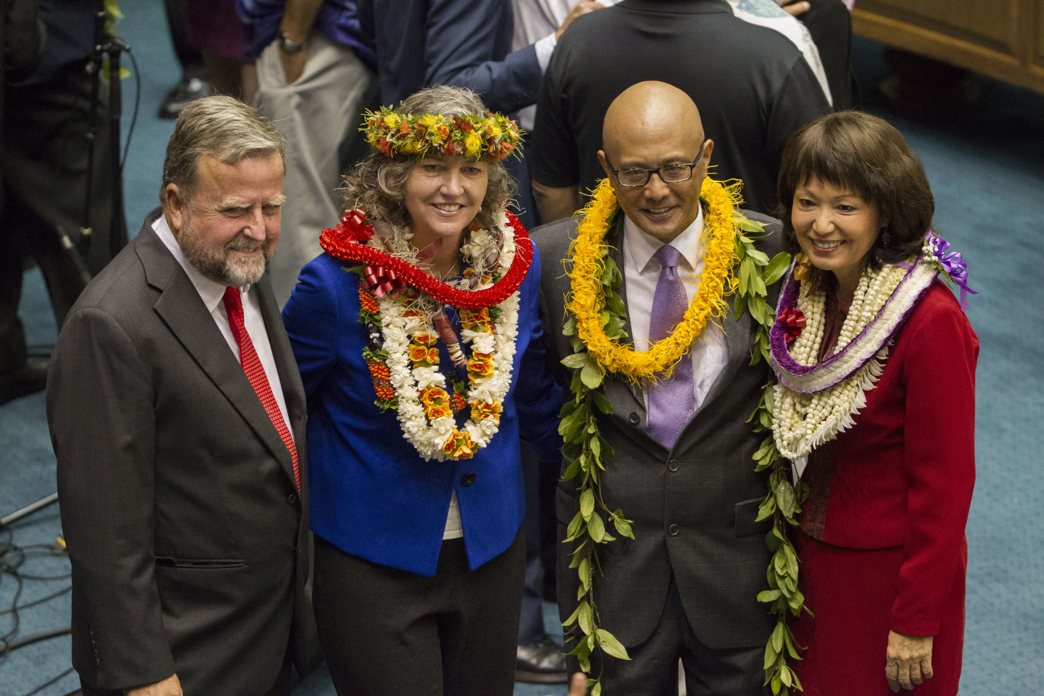 <p>Posing for a picture before the opening day sessions are, from left, former Sen. and Kaui Council member Gary Hooser, Sen. Laura Thielen, Sen. Will Espero and Sen. Donna Mercado Kim.</p>