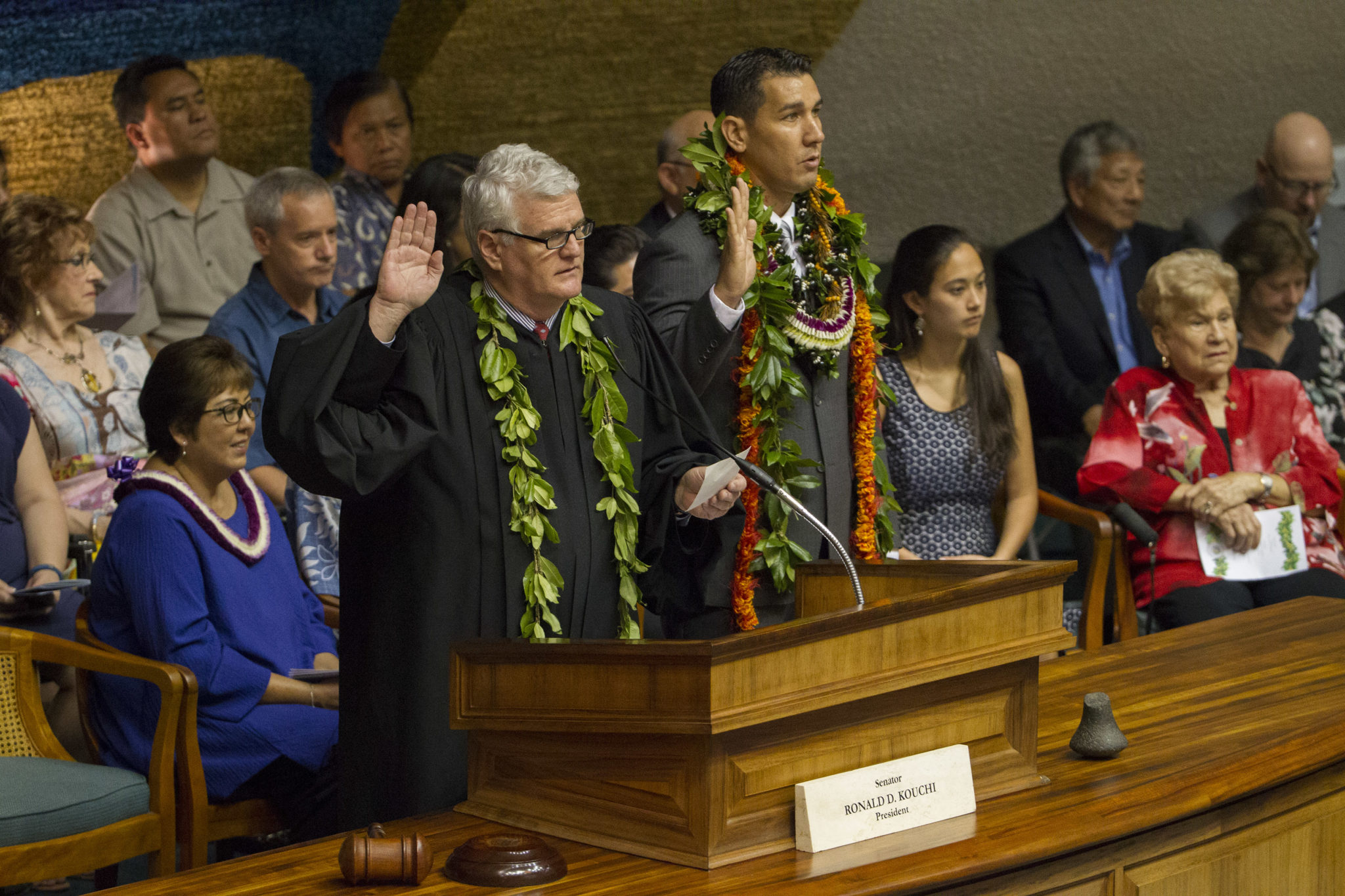 <p>Mark Recktenwald, left, chief justice of the Hawaii Supreme Court, administers the oath of office as Sen. Kaialii Kahele, temporary chair, looks on.</p>