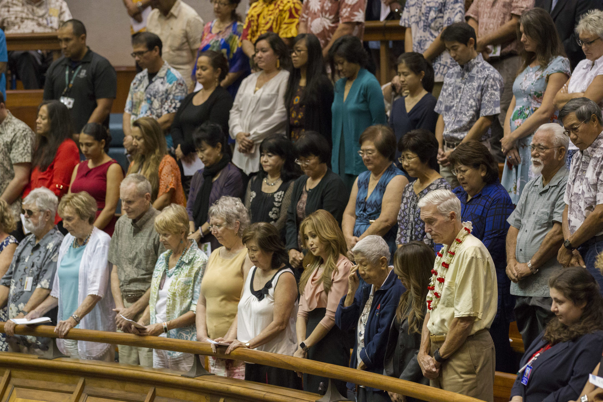 <p>Members of the public join in prayer at the start of the the House session.</p>